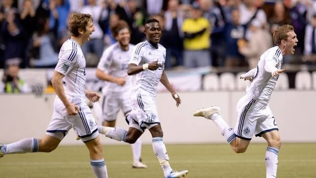 Vancouver Whitecaps celebrate a goal over FC Edmonton during the second half in Vancouver on Wednesday, May 1, 2013.
