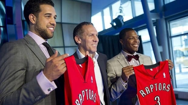 Toronto Raptors president and general manager Bryan Colangelo (centre) introduces new players Landry Fields (left), and Kyle Lowry at a news conference.