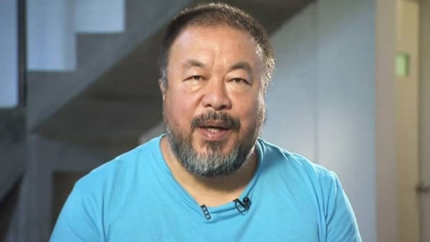 Ai Weiwei connects with Q host Jian Ghomeshi via video feed from his home in Beijing.