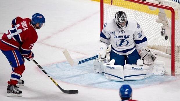Montreal Canadiens' Brian Gionta scores past Tampa Bay Lightning goaltender Ben Bishop.
