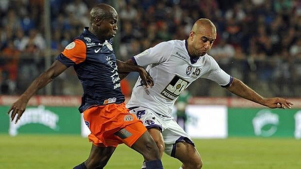 Montpellier forward Souleymane Camara (left) vies with Toulouse's defender Aymen Abdennour (right) during the French L1 soccer match.