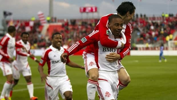 Toronto FC midfielder Reggie Lambe, right, is congratulated by teammates including Eric Avila, on his back, after scoring on the Montreal Impact on Wednesday night.