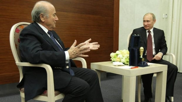 FIFA President Joseph Blatter, left, shown here in 2010, expects some clarification from Russian Premier Vladimir Putin, right, on the country's anti-gay laws soon.