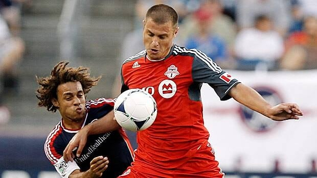 Danny Koevermans of Toronto FC, right, is seen battling the New England Revolution on July 14, 2012, the match in which he was injured.