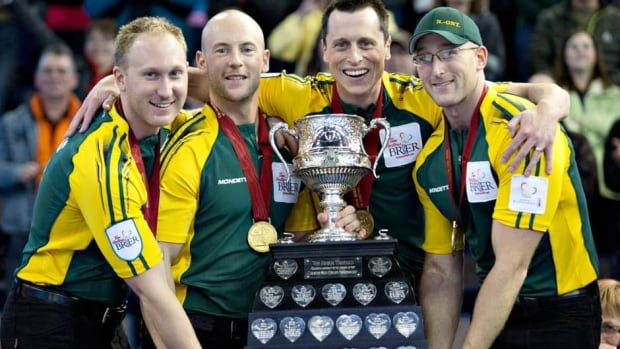 Team Northern Ontario members, from left, Brad Jacobs, Ryan Fry, E.J. Harnden and Ryan Harnden hoist the Brier Tankard after defeating team Manitoba during the championship draw at the Tim Hortons Brier in Edmonton on Sunday.
