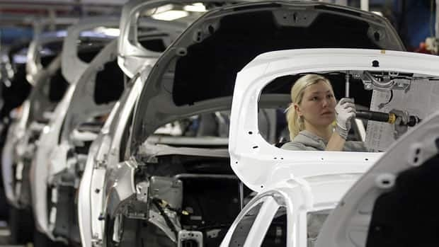Workers build Ford Fiestas at a factory in Cologne. The eurozone economy has slipped further into recession in the fourth quarter of 2012, contracting 0.6%.