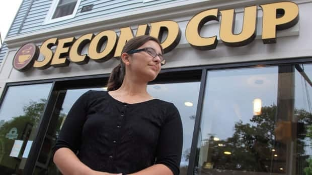 Shelby Kennedy stands outside a Second Cup coffee shop on Friday, May 5, 2013 in Halifax, Nova Scotia. Kennedy, who has worked at the store location for over a year, is participating in an union drive there that she hopes will serve as a model for baristas across Canada.