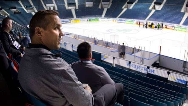 Executive director Steve Yzerman watches a Team Canada practice Saturday in Stockholm, Sweden. Canada is seeking its first world hockey championship gold medal since 2007.