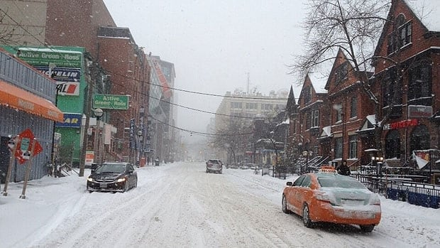 John Street in Toronto sees a dump of snow Thursday, ahead of a major snow system expected to hit the area. Evan Mitsui/CBC