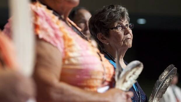 Josie Kipling holds an eagle feather considered sacred during the pipe ceremony during the opening ceremonies for the annual general assembly in Toronto. This year, leaders will meet in Halifax for three days in July. (Michelle Siu/Canadian Press)