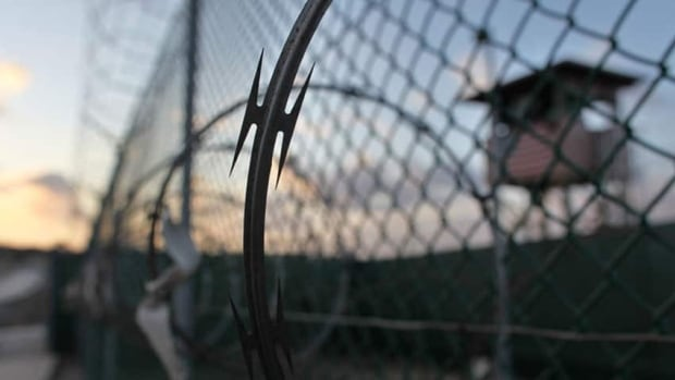 May 2009 file photo reviewed by the U.S. military, the sun rises over the Guantanamo detention facility at dawn, at the Guantanamo Bay U.S. Naval Base, Cuba.
