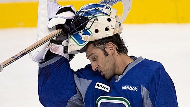 Vancouver Canucks goaltender Roberto Luongo adjusts his mask during a practice the past season.