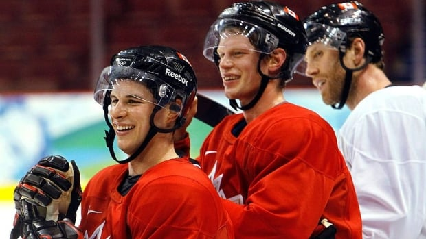 From left, Sidney Crosby, Eric Staal, and Joe Thornton share a laugh at a Team Canada practice at the 2010 Vancouver Olympics. They will be sporting red and white again from Aug. 25-28 at the team's Olympic orientation camp in Calgary.