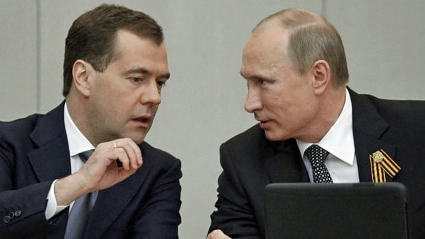Russian president Vladimir Putin, right, confers with his protege, prime minister Dmitry Medvedev. Putin has sent Medvedev in his place to the G8 summit in the U.S., the White House said Wednesday.