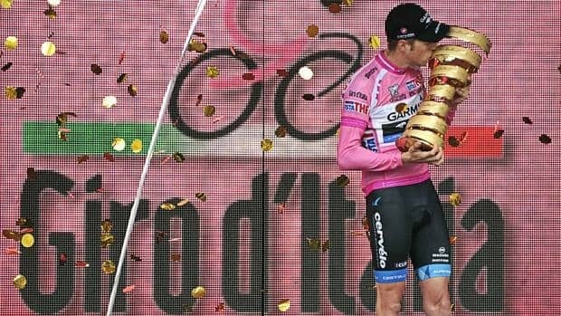Canada's Ryder Hesjedal kisses the trophy after winning the 95th Giro d'Italia, Tour of Italy cycling race, in Milan. Hesjedal finished 16 seconds ahead of Joaquin Rodriguez in the general classification after overhauling the Spaniard's lead on the final stage in Milan.