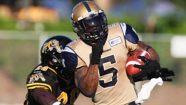 Winnipeg Blue Bombers running back Chad Simpson, right, and his squad will hope to get by the Hamilton Tiger-Cats on Friday.