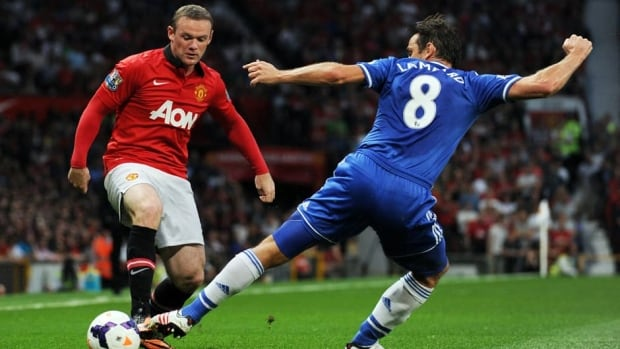 Manchester United's Wayne Rooney, left, competes with Chelsea's Frank Lampard during the match between at Old Trafford in Manchester on August 26, 2013.