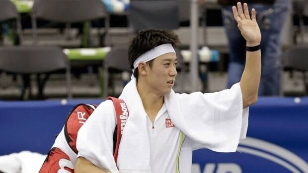 Kei Nishikori waves to the crowd following his win against Marinko Matosevic in a semifinal match at the U.S. National Indoor Championships on Saturday in Memphis, Tenn.
