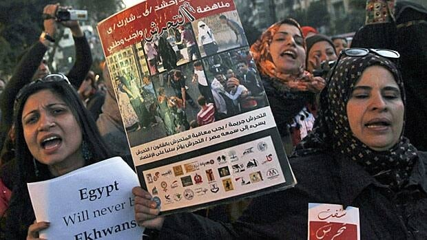 Egyptian women shout slogans against President Mohammed Morsi and the Muslim Brotherhood during a march protesting against sexual harassment and violence against women in Cairo in February 2013.