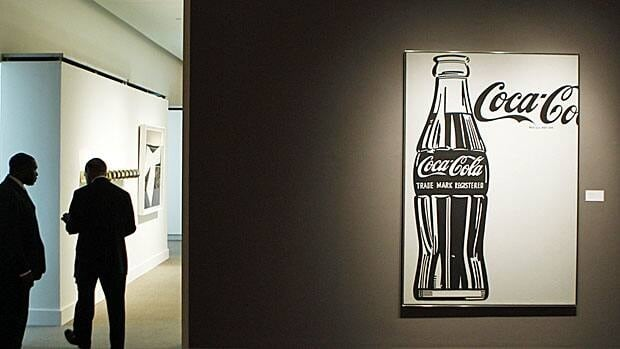 Security guards monitor Andy Warhol's Large Coca-Cola print at a Sotheby auction in New York in 2010. Britain recently banned a Coke ad that it said misled consumers.