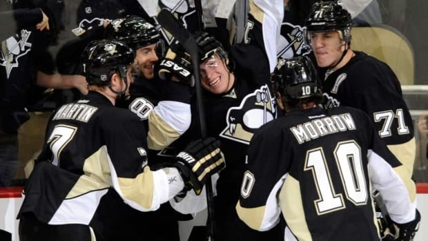 Pittsburgh Penguins celebrate Beau Bennetts' (19) first period goal against the New York Islanders in Game 1 Wednesday.