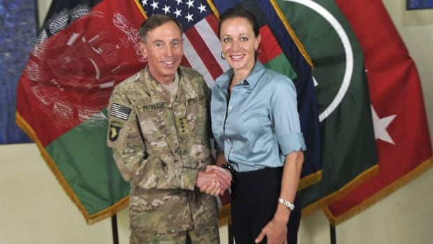 Paula Broadwell, right, the former mistress and biographer of retired general David Petraeus, left, will not face cyberstalking charges, her lawyer says.