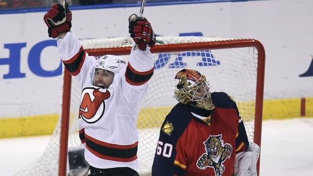 New Jersey Devils forward Stephen Gionta celebrates after scoring a goal against Florida Panthers goalie Jose Theodore during the second period of Game 7 on Thursday night.