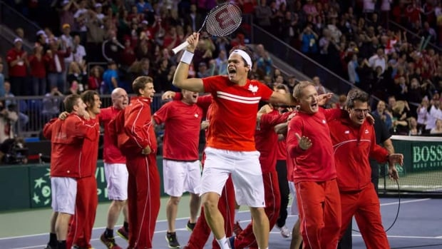 Canada's Milos Raonic, front, celebrates an historic Davis Cup quarter-final win against Italy's Andreas Seppi Sunday in Vancouver. The Canadians will now make their first-ever semifinal appearance.