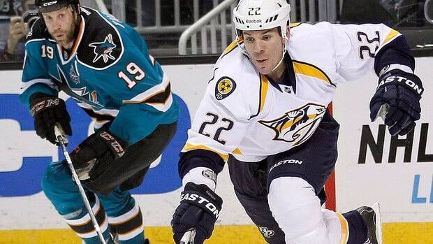 Predators defenceman Scott Hannan, right, soon will be reunited with former teammate Joe Thornton, left, in San Jose after Nashville traded him on Wednesday.