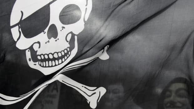 A pirate flag is seen at a protest in Berlin against the Anti-Counterfeiting Trade Agreement (ACTA), which aims to curb digital piracy of copyrighted intellectual property. The clampdown on the sharing of copyrighted music, movies and television online has intensified in recent years, and now, a new study out of the U.K. has shown that those who share content are regularly monitored and that the information collected could potentially be used as evidence in court cases against file sharers.