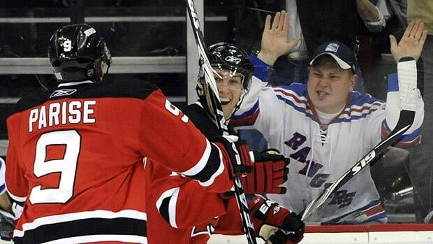 A Rangers fan made the short trip to New Jersey's home rink in this 2009 game to share his love of the Devils.