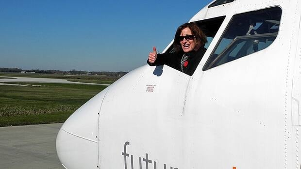 Mohawk College VP Academic Cheryl Jensen showing her approval from the pilot's seat Mohawk's new Boeing 727.