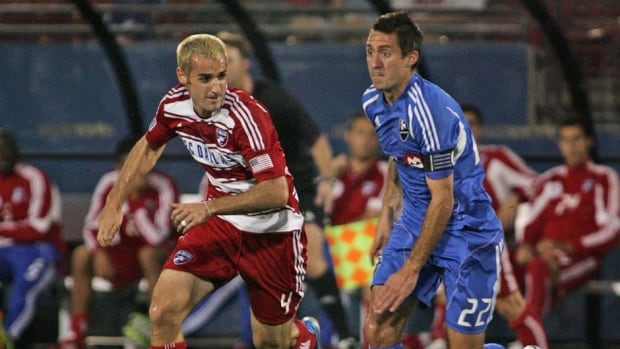 Andrew Jacobson of FC Dallas, left, and Davy Arnaud of the Montreal Impact at FC Dallas Stadium on April 14, 2012 in Frisco, Texas.