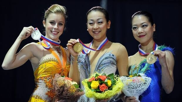 Japan's Mao Asada, centre, American Ashley Wagner, left, and Japan's Akiko Suzuki hold their medals after the awards ceremony at the ISU Grand Prix of Figure Skating Final in Sochi, Russia on Saturday.