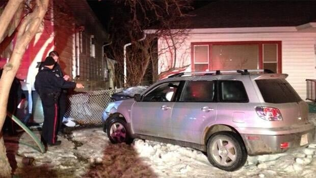 The front of this car caught fire when it crashed into a house on Connors Road early Monday morning.