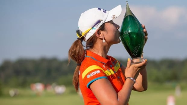 Hee Young Park of South Korea kisses the trophy following her victory at the Manulife Financial LPGA Classic in Waterloo, Ont., on Sunday.