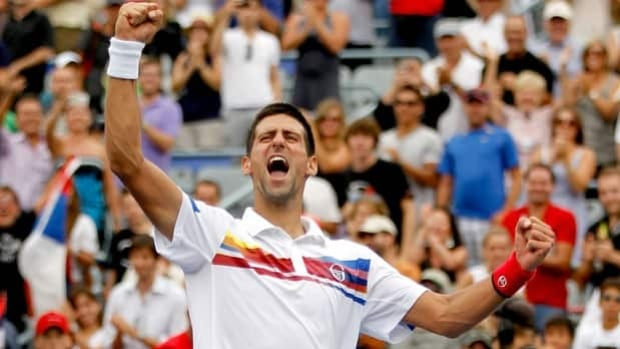 Novak Djokovic exults in winning the Rogers Cup at Uniprix Stadium on Aug. 14, 2011.