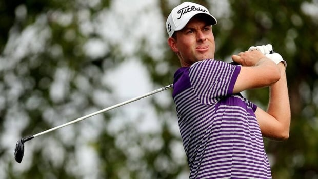 Webb Simpson watches his tee shot on the 17th hole during a continuation of the first round of The Barclays at Liberty National Golf Club on Friday in Jersey City, N.J.