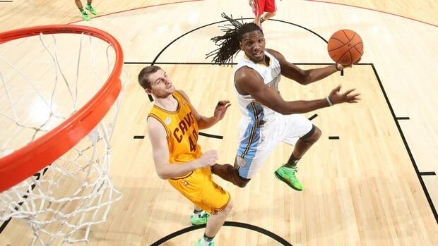Kenneth Faried of Team Chuck, right, shoots against Tyler Zeller of Team Shaq during the 2013 BBVA Rising Stars Challenge at Toyota Center on February 15, 2013.