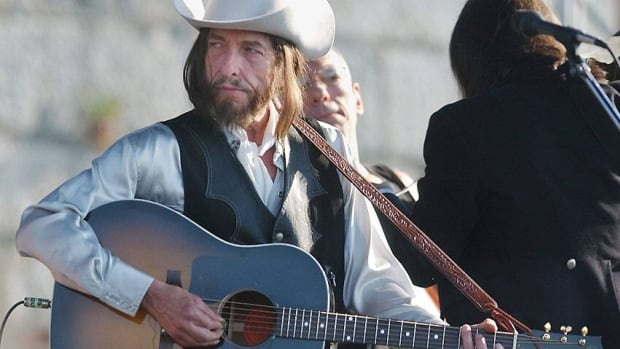 Bob Dylan, seen performing at the Newport Folk Festival in 2002, reached an undisclosed settlement with Dawn Peterson over his famed 'Dylan goes electric' guitar.