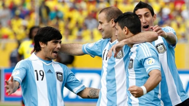Argentina's Sergio Aguero (second right) and teammates Ever Banega (left), Rodrigo Palacio and Angel Di Maria celebrate (right) after Aguero scored a goal against Ecuador in their 2014 World Cup qualifying soccer match Tuesday in Quito.