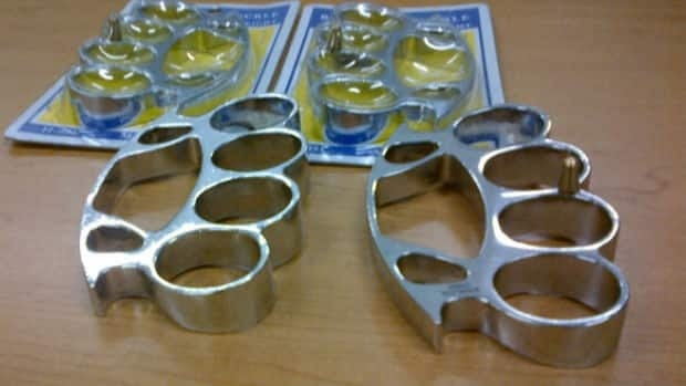 Officers confiscated four sets of brass knuckles from the youth.