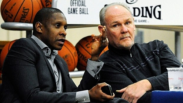 George Karl, right, is shown with Masai Ujiri, who was wooed from Denver to Toronto by a lucrative offer to turn around the Raptors.