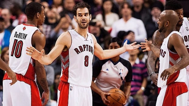 Toronto's DeMar DeRozan, left, had high praise for Jose Calderon, centre, who recorded the second triple double of his career.