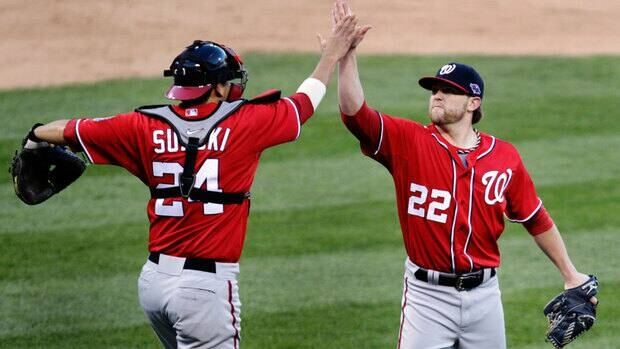 Washington Nationals relief pitcher Drew Storen, right, and catcher Kurt Suzuki celebrate their 3-2 win over the St. Louis Cardinals in Game 1 of the National League division series Sunday.