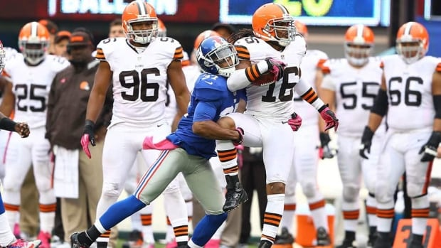 Will Hill of the New York Giants is seen here tackling Cleveland Browns' Josh Cribbs last year. The Giants' safety was suspended four games for violating the NFL's substance abuse policy on Saturday.