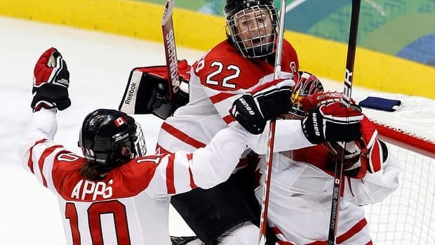 Gillian Apps, left, scored twice in Canada's 3-1 win over the United States at the Four Nations Cup Wednesday. Hayley Wickenheiser, middle, added an insurance goal.