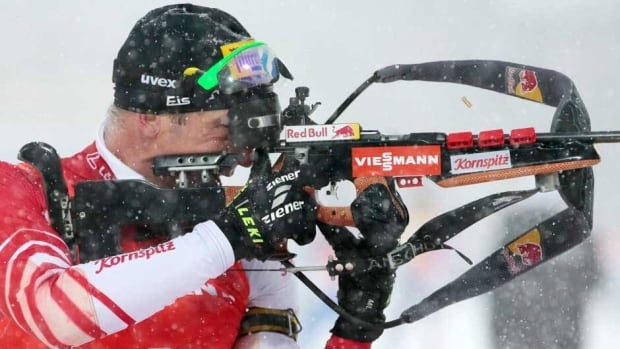 Winner Christoph Sumann of Austria fires at a target at the shooting range during the men's 12.5 km pursuit at the IBU World Cup Biathlon at Khanty-Mansiysk, Russia, Saturday.
