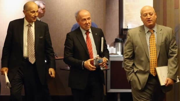 Boston Bruins owner Jeremy Jacobs, left, Larry Tanenbaum of the Toronto Maple Leafs, middle, and NHL deputy commissioner Bill Daly were expected to attend Wednesday's board of governors meeting in New York.