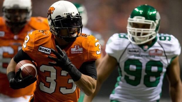 B.C. Lions' Andrew Harris, seen rushing for a touchdown on Nov. 3, is downplaying the battle for better stats Sunday with Jon Cornish of Calgary.